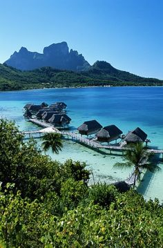 Bora Bora, French Polynesia: In the heart of French Polynesia, Bora Bora exists as a sort of honeymoon-land. Glam ladies like Charlize Theron, Sharon Stone and Nicole Kidman have been spotted lounging on its golden beaches, most likely taking advantage of the private beach huts and tropical bungalows that offer views of volcano peaks and cobalt lagoons. (Getty Images)