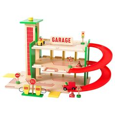 This Wooden Garage Toy is a superb retro style wooden garage from Moulin Roty. This set comes with 11 wooden accessories: 2 cars, road signs, cones Wooden Toy Garage, Station Essence, Non Toxic Paint, Le Moulin, Wood Toys, Classic Toys, Gas Station, Primary Colors, Playground