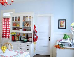 Love the light/white cabinetry with the brightly colored accents