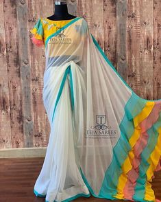Available Stylish multi colour ruffled Pallu on a Half white Georgette saree teamed with a yellow hand work blouse from Team… Saree Blouse Patterns, Designer Blouse Patterns, Fancy Blouse Designs, Pattern Blouses For Sarees, Dress Designs, Fancy Sarees, Party Wear Sarees, Hyderabad, Teja Sarees