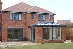 We supply and install structures just like this modern orangery all over the South East. This combined uPVC grey windows in the main house with aluminium. Exterior House Remodel, House Front, House Windows, Brick Exterior House, Windows Exterior, House Exterior, Upvc Windows, House Extension Design, Red Brick House