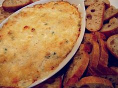 Hot Crab Dip on noble pig.com Hot Crab Dip Recipe from: Al Roker's Hassle Free Holiday Cookbook | Serves: 6-8 Ingredients  8 oz cream cheese, softened 1/2 cup mayonnaise 1 Tablespoon lemon juice 1/4 teaspoon hot pepper sauce 3 green onions, finely chopped 12 oz (2 cups) lump crab meat 1/2 teaspoon each salt and freshly ground pepper 3 Tablespoons freshly grated Parmesan cheese sliced French or sourdough bread
