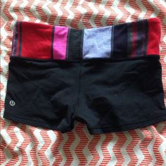 Lululemon boogie shorts Size 6 Reversible All black side has some piling Colorful side is good condition lululemon athletica Shorts