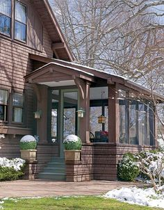 A glassed-in sun porch with bungalow lines adds seasonal living space.