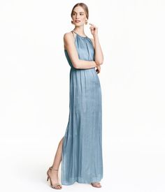 Long, sleeveless dress in airy woven fabric. Elasticized seam at waist, open back, metal buckle at back of neck, and high slits at sides. Double-layer fabric in bodice and skirt with short liner skirt.
