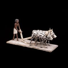 Wooden model of a man ploughing with oxen  From Egypt Middle Kingdom, about 2040-1750 BC  An ancient Egyptian farmer at work