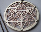 Small Star Tetrahedron and Flower of Life pendant - copper and sterling silver. $120.00, via Etsy.