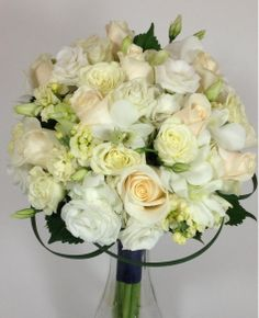 Bridal Bouquet, White & Green roses, lisianthus, bear grass, stock and orchids. Harriet's Flowers, Ruskin, FL