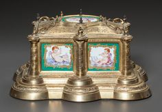 Decorative Arts, Continental, A SÈVRES-STYLE GILT AND PAINTED METAL JEWELRY BOX. 19th century. 5x 9 x 7 inches (12.7 x 22.9 x 17.8 cm). ... ...