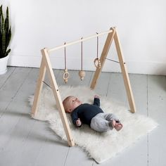 Make this simple, easy-to-store, wood baby gym for a sweet little one!