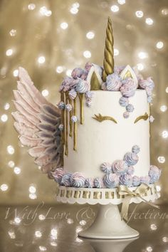Unicorn Drip Cake with Meringue Wings - Cake by Veronica Arthur of With Love & Confection. My version of the ever so popular Unicorn cake with meringue kisses and MERINGUE WINGS! White chocolate drip painted in gold luster. Cake is 4 layers of unicorn swi Unicorne Cake, Cake Art, Eat Cake, Cupcake Cakes, Pretty Cakes, Cute Cakes, Beautiful Cakes, Amazing Cakes, Meringue Kisses