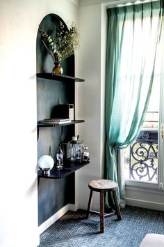 mint window treatments and black arched nook with shelves. / sfgirlbybay