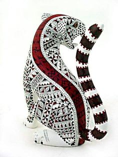 i really like its tail because the colors are plain but the pattern is creative, i like how the pattern on the body repeats, and how it has a red line going up its back. 7th Grade Art, Mexican Designs, Indigenous Art, Mexican Folk Art, Wood Sculpture, Spirit Animal, Painting On Wood, Wood Art, Sculpting