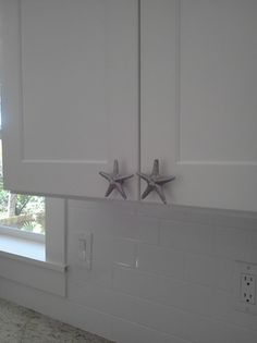 Beach Starfish cabinet knobs.  Live the island life outside and inside.  Anna Maria Island Homes for Sale. http://pamelakemper.com/2/post/2013/10/-is-this-beachy.html