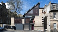 Secret hatches, moving walls and a sliding ladder feature inside the Edinburgh home of Richard Murphy, which has been named RIBA House of the Year 2016