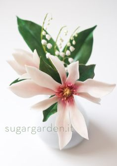 _ Magnolia flower with the delicate Lily of the Valley