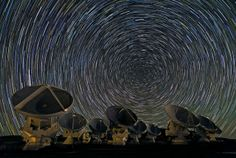 Whirling Southern Star Trails over ALMA.  The photograph was taken on the Chajnantor Plateau, at an altitude of 5000 metres in the Chilean Andes.   Atacama Large Millimeter/sub-millimeter Array (ALMA) - In search of our Cosmic Origins