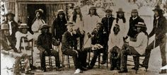 Apache men at Mt. Vernon Barracks in Alabama - no date *Standing L-R: Coonie, Binday, Fun, Chechil, Naiche, Geronimo, Tooisgah, Perico, unidentified *Sitting L-R: Kayitah, Chato, Loco, George Medhurst Wratten (non-Native Interpreter), Nana, Becalthey, Yahnozha