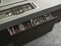 POLIFORM: a detail of the worktop with flush built-in personalised hob Varenna