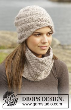 "Knitted DROPS hat and neck warmer with spiral pattern in ""Eskimo"". ~ DROPS Design"
