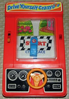 """Vintage Drive Yourself Crazy Handheld Electronic Game by Tomy, Model No. 7011, Powered by 1 """"C"""" Battery, A Very Basic Handheld Game, Made in Hong Kong, Copyright 1976."""