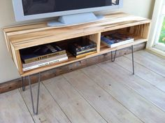Mid century modern TV table/entertainment console featuring wormy maple with hairpin legs.