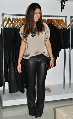 With a leather skirt and peep toe, ankle strap wedges..SN