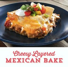 Lasagna goes south of the border in this delicious Cheesy Layered Mexican Bake! Made with melty cheese, beef, sausage and beans, layered in corn tortillas! It's hearty comfort food ready in just 35 minutes!