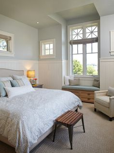 Pretty bedroom with pale blue walls and white wainscoating. Guesses on the color from commenters are Sherwin Williams 6217 Topsail, Sherwin Williams Sea Salt, Sherwin Williams Silver Strand. Trim is probably Benjamin Moore White Dove