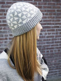 This eye-catching hat features a playful geometric Fair Isle motif and a wide brim that can be folded up for added warmth, or left unfolded for a more casual slouchy style. The hat is worked in the round from a chart that features easy to understand integrated crown shaping, and comes in two sizes.
