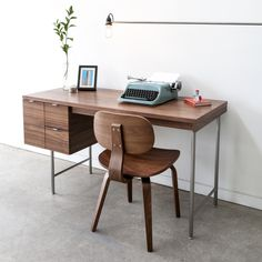 Gus* Design Group Inc - Conrad Desk (New for 2013) - The Conrad Desk is a compact home office desk with a strong Mid-Century pedigree.  All surfaces are finished in walnut, to contrast the slender, tubular stainless steel legs and drawer pulls. The main drawer is designed to hold hanging file folders, and the two smaller drawers are perfect for organizing stationary and supplies – Showroom: IHFC H512 #hpmkt