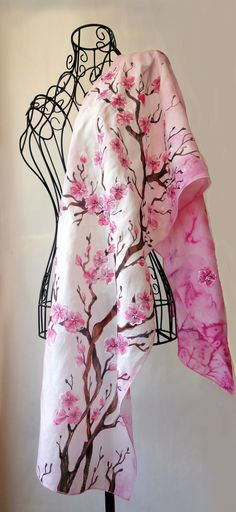 Hi! This is 100% pure silk and hand painted one-of-a-kind piece of wearable art. The Sakura, or cherry blossom, is a small flower that blooms in the spring. Several cultures of the indigenous countries that the sakura is home to have different meanings. In China, the blossom