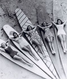 VINTAGE SURF SIRENS Photograph by Ray Leighton (via National Library of Australia) In this vintage photo we see five lovely ladies posing on top of some old-school surfboards. The photograph was taken by Ray Leighton between 1938 and 1946 at Manly beach in New South Wales, Australia.