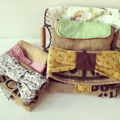 Burlap bags with recycled cloth bows and trimmings by Arteesta.  www.bellysprout.com