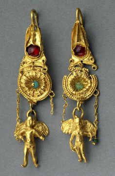 Greek, Hellenistic Pair of earrings with Erotes and Isis crowns, late 3rd – 2nd century B.C. Gold, garnet, and glass