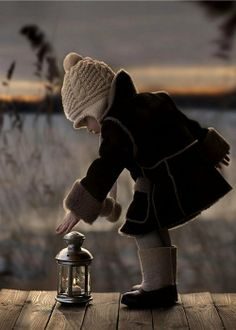 *** (by Elena Shumilova)   /  What a lovely photograph of a little girl in perfect colors for the location.  Cute as a button.