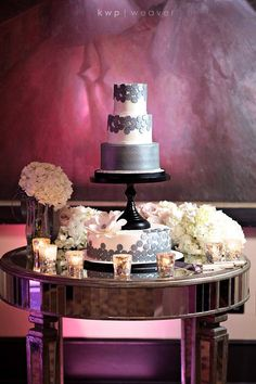 Feast your eyes on one of our most unique cake displays from a wedding last week. This cake is four tiers, but has the cake stand on top of the bottom layer! Combined with the sophisticated gray color and you get one outstanding cake! Floral by GREENERY PRODUCTIONS INC. Photo by Kristen Weaver Photography.