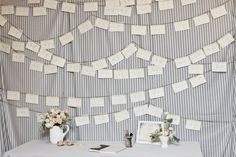 Cards or sheets of paper on a string