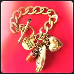 "Juicy Couture Silver Beach Bum Charm Bracelet Gently worn - good condition - includes heart, surfboard, Apple and 'J' charms - approximately 7 1/2"" long Juicy Couture Jewelry Bracelets"