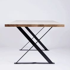 Side view of The Alexandria Dining Table. Made from Solid American White Oak Timber and Wood and Black Steel Legs. Available in our online store.
