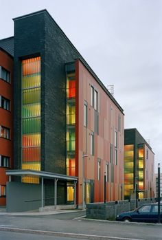 Muurikuja 1 Housing does not attempt to be in harmony with its multifaceted context. The facades collage of colors, reds, oranges, greens, and yellows stand