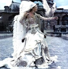 gorgeous dress, feathers, indian influence, lots of jewelry, pearls, owl, castle, white, cream, mask, cobblestone