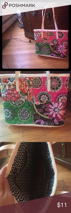 Vera Bradley Medium-large handbag Very cute patchwork tote with bright Vera prints. Can easily fit wallet, keys, phone, and tablet. Probably could not fit normal sized laptop. Some scuffing on bottom, but not noticeable unless you flip the bag over Vera Bradley Bags Totes