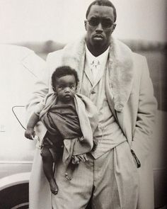 """Annie Leibovitz photograph of Sean """"Puffy"""" Combs and his son Christian for the Vanity Fair Hall of Fame editorial."""