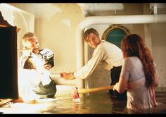 "James Cameron, Leonardo DiCaprio, Kate Winslet on the set of ""Titanic"""