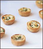 At restaurant Daniel, Daniel Boulud makes these popular bite-size mushroom quiches in individual molds, but mini-muffin pans are perfect substitutes.  Plus: More Appetizer Recipes and Tips