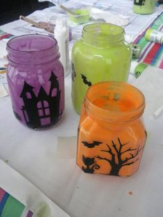 I made these jars a few years ago.  I have been asked a few questions about the process, so here is a more detailed set of instructions.    Supplies: jars, craft paint, white school glue, vinyl mot…