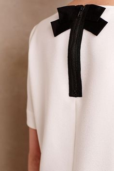 Elegant white blouse with black zipper  and bow at back.. DIY the look yourself: http://mjtrends.com/pins.php?name=black-zipper-for-blouse