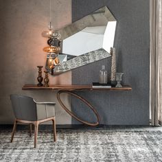 TOUR Design: Giorgio Cattelan Console with base in graphite embossed lacquered steel (GFM69) and leg in Canaletto walnut (NC). Top in clear glass. Max capacity 10 kg spread load. Wall anchorage is required.