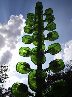 bottle tree with extra large bottles, photo by danenestos on Flickr